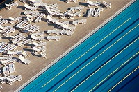 Swimming pool and deck chairs. Barcelona. Spain