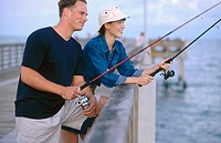 couple fishing on a pier