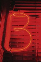 B on neon sign