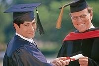 Graduate accepting diploma, portrait