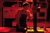 Photographer in darkroom