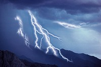 Multiple lightning bolts striking land