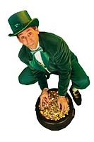 Leprechaun dipping hands into a pot of gold