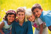 Group of kids in field smiling, portrait