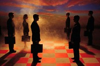 Businesspeople on chessboard