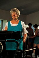 Mature woman jogging on treadmill