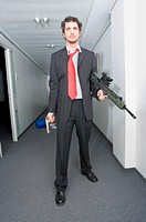 Businessman with a rifle and handgun