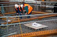 Men up on construction site