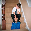 Child sitting on stairway