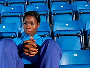 Athlete sitting in empty stadium