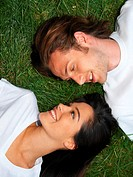 Young couple relaxing on grass (thumbnail)