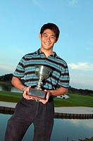Asian man holding a trophy
