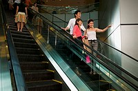 Young people on escalator