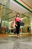 Woman leaving clothes store