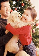 Father Giving His Daughter a Labrador Puppy as a Christmas Present