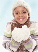 Smiling Girl Wearing Warm Clothing Holding Fake Snow