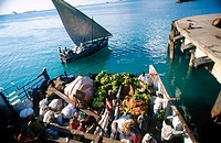 Pemba ferry from Mkoani with bananas and other goods for market coming into dock at Stonetown, Zanzibar, Tanzania
