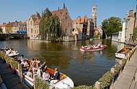 Tourists on boat by Groenerei and Rozenhoedkaai. Brugge. Flanders, Belgium
