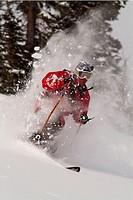 Man skiing powder snow in the Sawtooth Mountains of Idaho near Mount Williams. USA