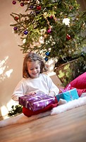 child unwrapping present, Christmas