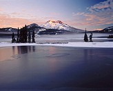 Sunrise on South Sister from Sparks Lake after fall snowstorm. Deschutes National Forest, Deschutes County. Central Oregon. USA.