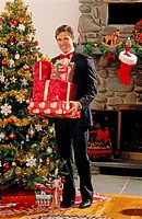 Man in tux with Christmas presents