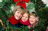 Sisters framed by Christmas wreaths