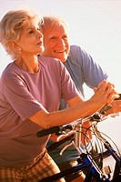 Senior couple standing with bicycles