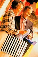 Couple examining a garment while shopping