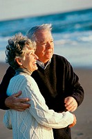 Senior couple holding each other at the beach