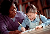 Woman assisting an elementary student