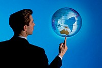 Businessman spinning a globe on his finger