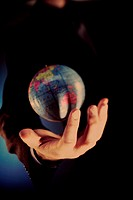 Close-up of a person´s hand holding a globe