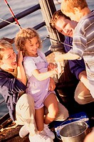 Couple in a fishing boat with their son and daughter (thumbnail)