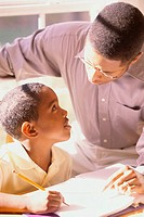 Close-up of a father tutoring his son