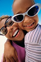 Portrait of a mother and daughter wearing sunglasses