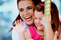 Close-up of a woman on a carousel with her daughter