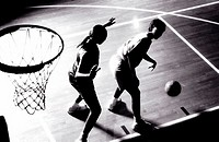 High angle view of two women playing basketball
