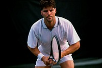 Portrait of a young man playing tennis