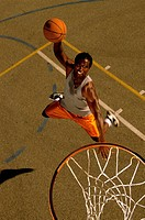 High angle view of a basketball player slam dunking a ball