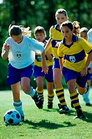 Group of girls playing soccer