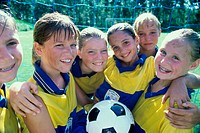 Portrait of a smiling girls soccer team