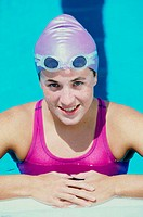 Portrait of a young woman standing in a swimming pool