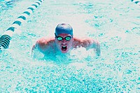 Young man swimming in a swimming pool