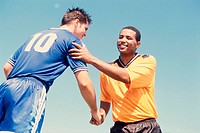 Low angle view of two soccer players shaking hands
