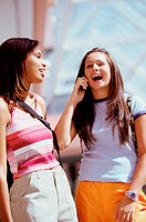 Two teenage girls laughing