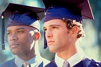 Close-up of two young men in graduation outfits