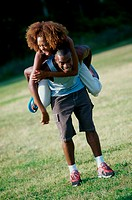 Woman riding piggyback on a young man