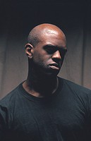 A portrait of a black male/ head and shoulders