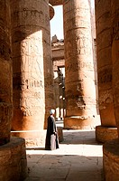 A caretaker at Karnak surveys the massive columns. Luxor. Egypt